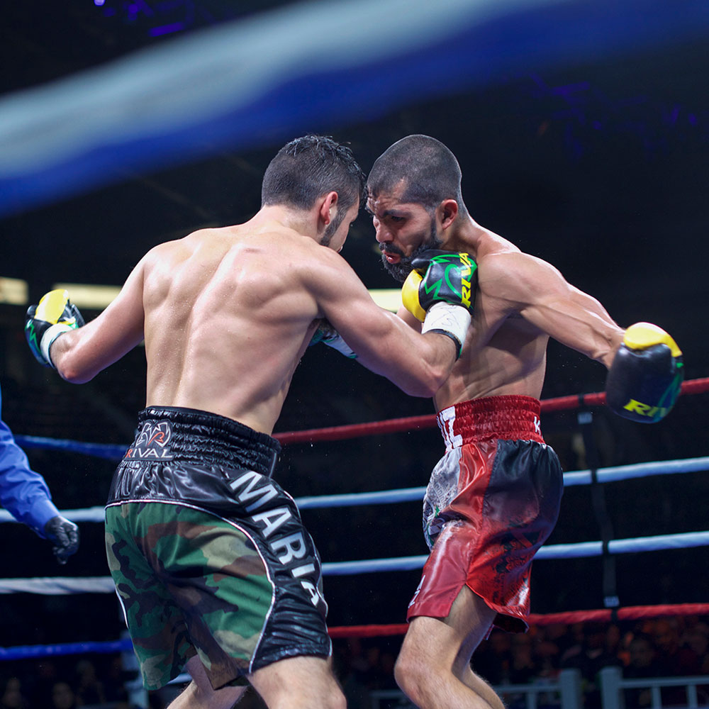 professional boxer tony luis and Christian Uruzquieta exchange punches during a boxing match