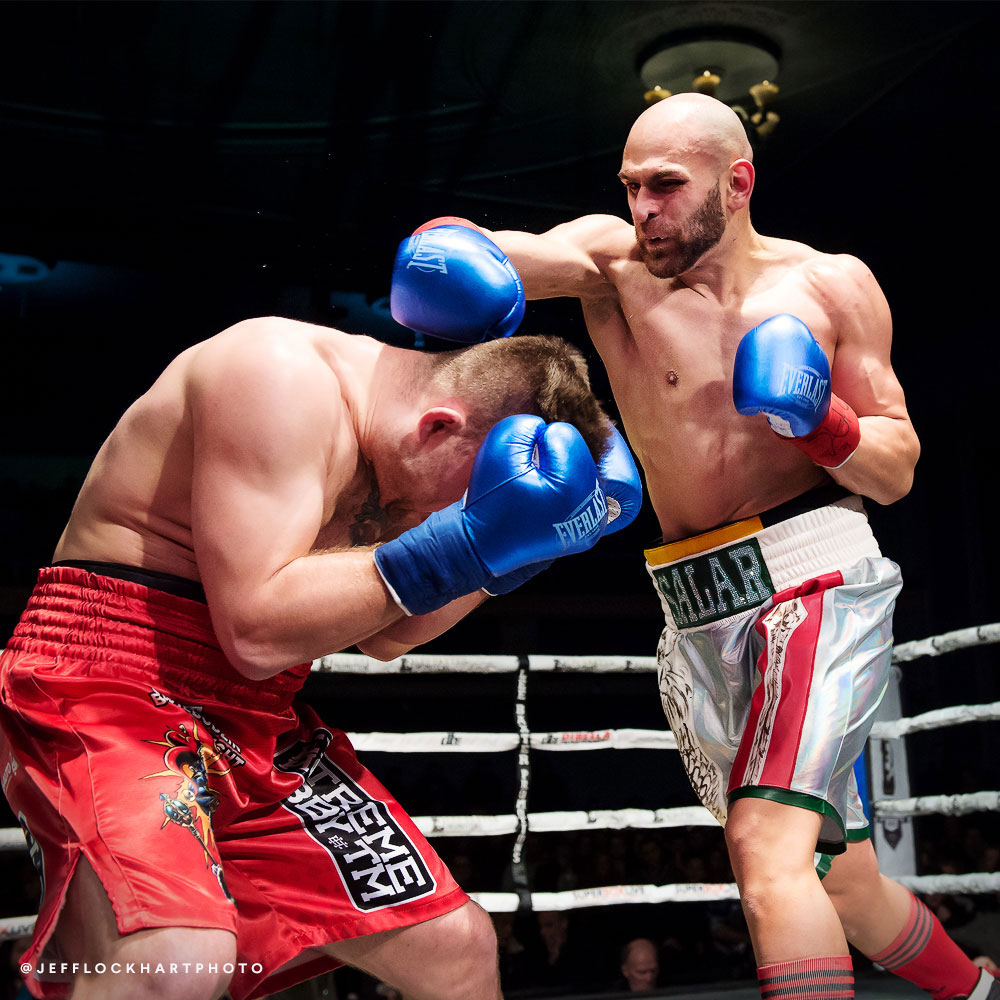 professional boxer salar gholami misses a right hand against Mateusz Kubiszyn during a boxing match