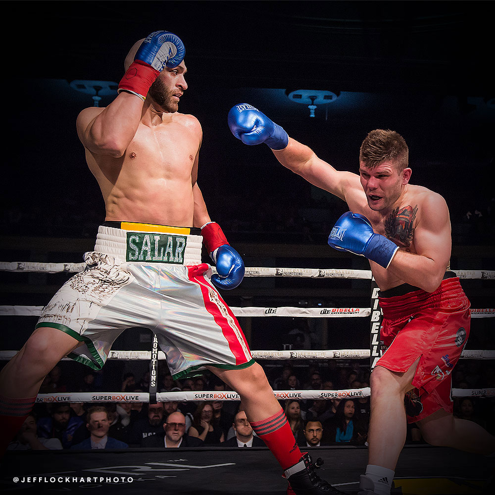 professional boxer salar gholami defends against a right hand by Mateusz Kubiszyn during a boxing match