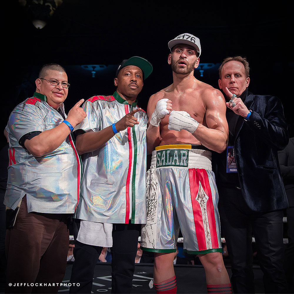 professional boxer salar gholami standing in boxing ring after fight against mateusz kubiszyn with ryan grant and gary freedman